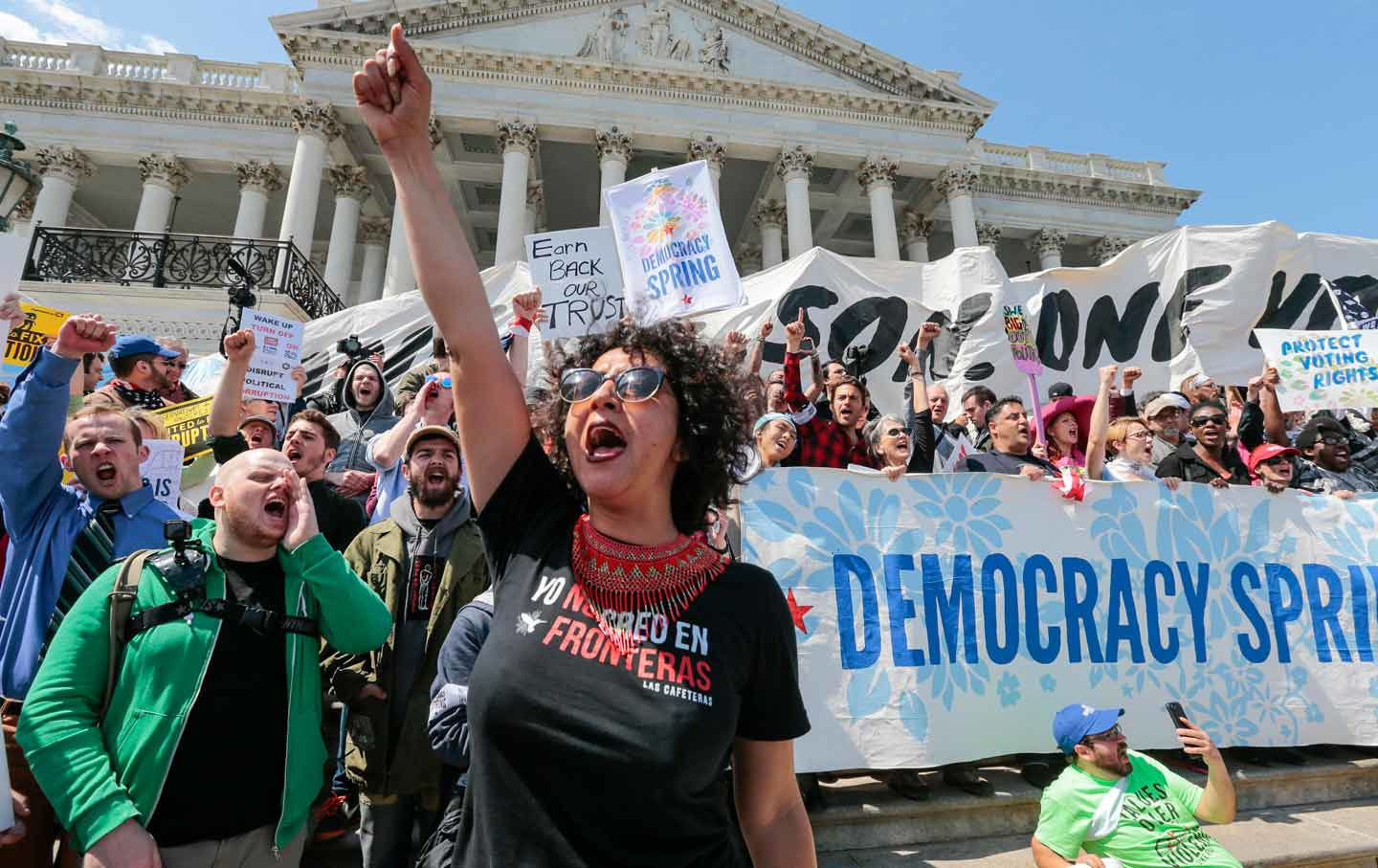This Arizona woman leads a chant as voting-rights demonstrators stage a sit-in at the Capitol. She's not part of the problem. (AP Photo / J. Scott Applewhite)