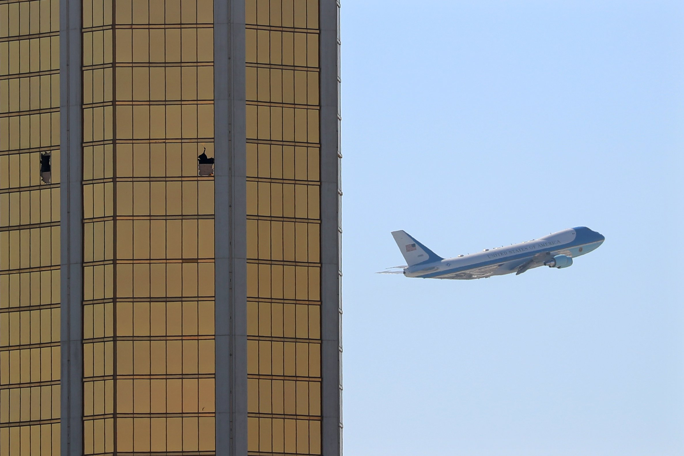 Air Force One departs Las Vegas on Wednesday, flying past the broken windows on the Mandalay Bay Resort and Casino. (Mike Blake/Reuters)